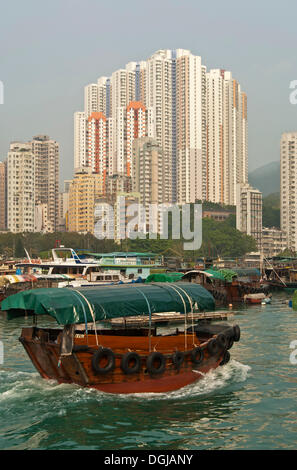 Sampan boat in Aberdeen Harbour, Sampan boat harbour, skyscrapers at Aberdeen Channel at back, Aberdeen, Hong Kong, - Stock Photo