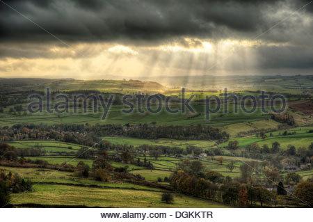 Sunbeams over Big Moor in the Peak District in Autumn. - Stock Photo