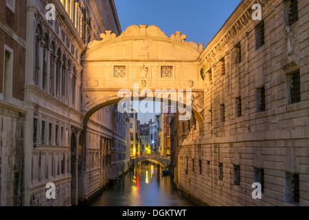 A view of the Bridge of Sighs in Venice after sunset. - Stock Photo