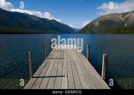 A jetty at Lake Rotoiti, mountains in the back, St. Arnaud, Tasman Region, South Island, New Zealand - Stock Photo