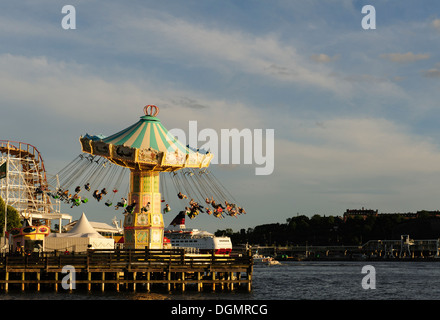 Merry go round at the Grona Lund amusement park in Stockholm - Stock Photo