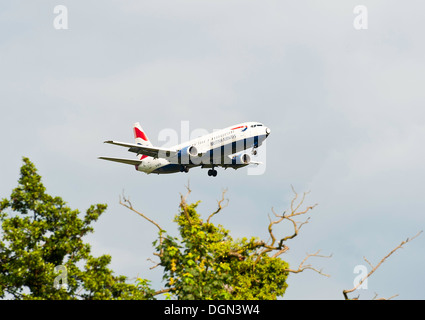 British Airways Boeing 737 Airliner G-GBTB on Landing Approach to London Gatwick Airport LGW West Sussex England - Stock Photo