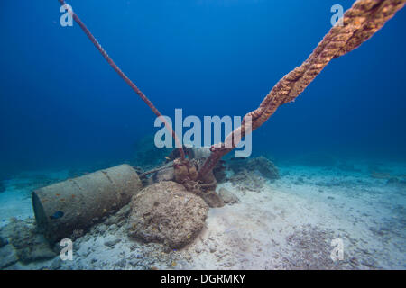 An anchor made of concrete blocks and old barrels at a coral reef, Philippines, Asia - Stock Photo