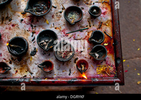 Oil lamps in an Indian temple - Stock Photo