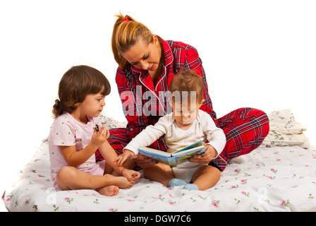 Mother with kids reading bedtime story isolated on white background - Stock Photo