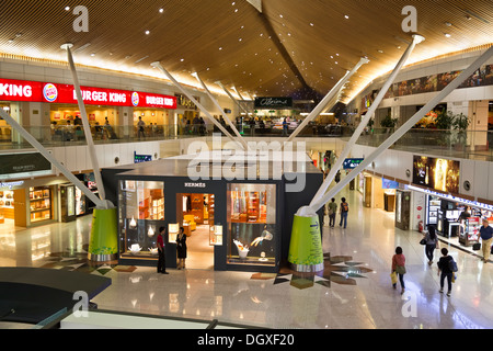 Kuala Lumpur International Airport KLIA satellite terminal building with duty-free shops and designer brand boutiques, - Stock Photo