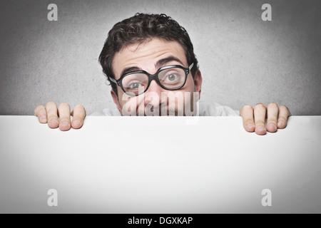 Man holding an empty cardboard - Stock Photo