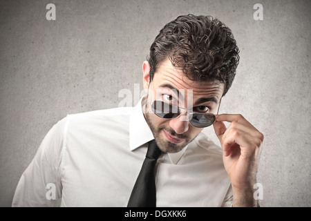 Portrait of an attracting man with sunglasses - Stock Photo