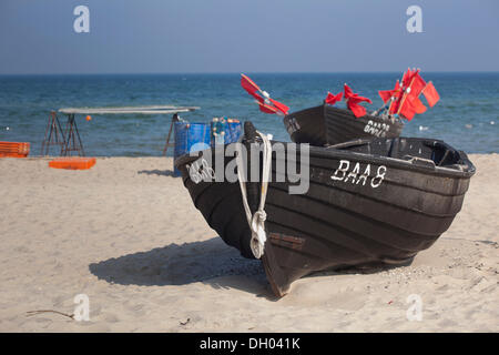 Old fishing boat on the beach of Baabe, Ruegen Island, Baltic Coast, Mecklenburg-Western Pomerania - Stock Photo
