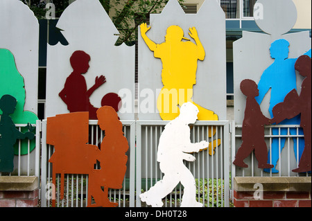 Metal mural showing children playing outside Elsie Roy Elementary School, Yaletown, Vancouver, British Columbia, - Stock Photo