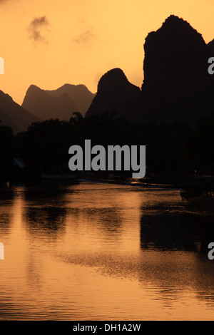 Sunset over the karst peaks on the Li River in south China - Stock Photo