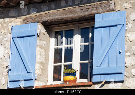 Blue shutters and window Gourdon Provence France - Stock Photo
