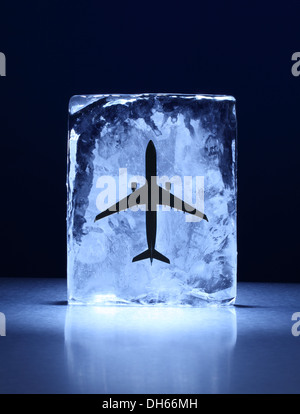 A model airplane frozen in a clear block of ice - Stock Photo