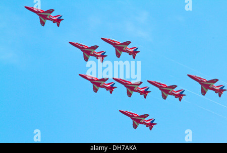 Eight Royal Air Force Red Arrows flying in formation - Stock Photo