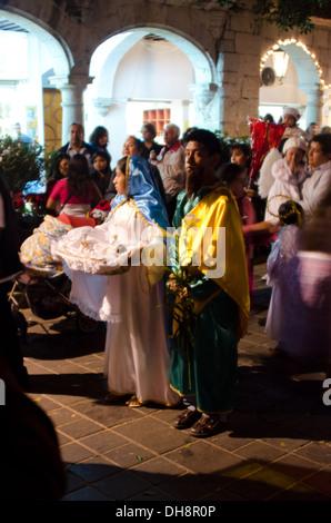girls in costume walking on stilts at kiddies carnival. Black Bedroom Furniture Sets. Home Design Ideas