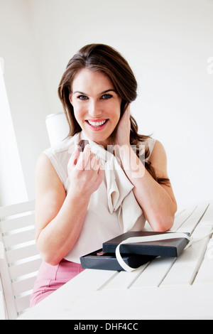 Young woman with box of chocolates - Stock Photo