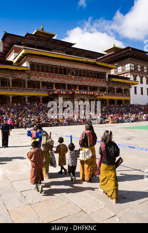 Bhutan, Thimpu Dzong, annual Tsechu, women and children entering festival ground - Stock Photo