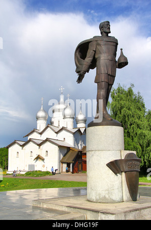 Statue of Alexander Nevsky and Church of Boris and Gleb on Volhov river's embankment in Veliky Novgorod, Russia - Stock Photo