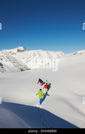 Friends walking through snow, Kuhtai, Austria - Stock Photo