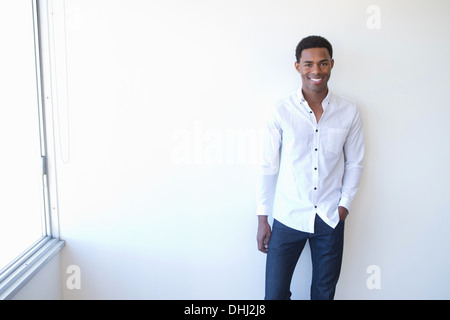 Portrait of young man wearing white shirt - Stock Photo