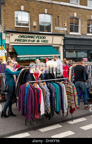 Clothes for sale in Broadway market, East London - Stock Photo