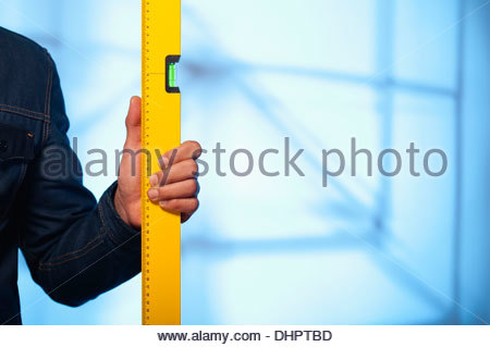 spirit level man hand construction holding builder - Stock Photo