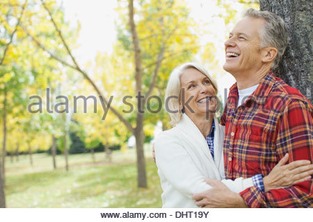 Happy mature couple at park - Stock Photo