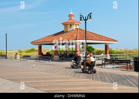 USA America New Jersey NJ N. J. Atlantic City Boardwalk two older people in motorized wheelchairs - Stock Photo
