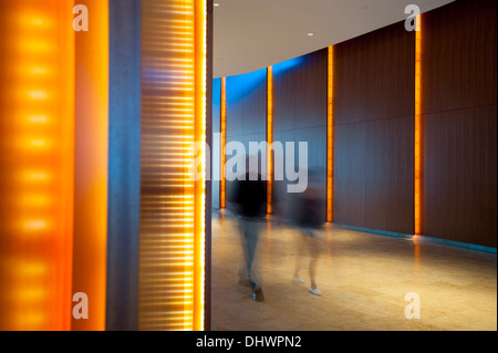 USA America New Jersey NJ N.J. Atlantic City Revel Casino Hotel on the boardwalk two people walk the hallway to - Stock Photo