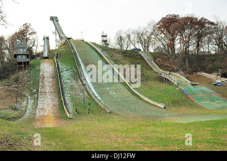 Ski Jumps and landing zones in autumn. - Stock Photo