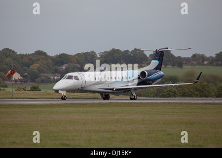 London Executive Aviation Embraer Legacy 600 G-THFC departing London-Luton Airport LTN - Stock Photo