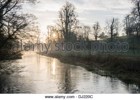 Mist rises from the River Lambourn as it runs through the grounds of Welford Park, Newbury, Berks, UK - Stock Photo