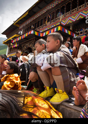 Bhutan, Thimpu Dzong, annual Tsechu, festival audience in front of monastery - Stock Photo