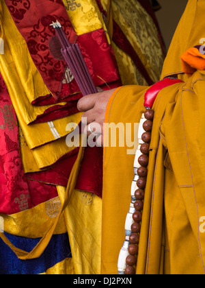 Bhutan, Thimpu Dzong, annual Tsechu, hands of monk holding smoking incense sticks - Stock Photo
