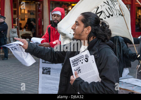 London, 22 November 2013. Radical Islamist preacher Anjem Choudary's Islam4UK hold a protest and leafleting outreach - Stock Photo