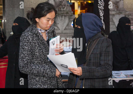 London, 22 November 2013. A woman from radical Islamist preacher Anjem Choudary's  Islam4UK speaks to a member of - Stock Photo