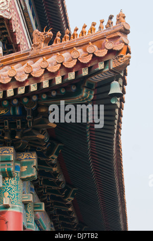 Roof details in Yonghe Temple also known as Yonghe Lamasery or simply Lama Temple in Beijing, China - Stock Photo