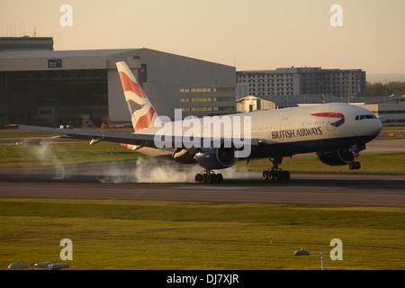British Airways Boeing 777 jet landing at London Heathrow Airport - Stock Photo