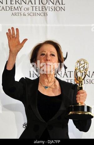 New York, NY, USA . 25th Nov, 2013. Brazilian actress Fernanda Montenegro poses after winning 'Best Performance - Stock Photo