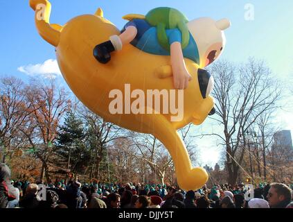 New York, USA. 28th November 2013. The pikachu balloon floats above the street during the Macy's Thanksgiving Day - Stock Photo