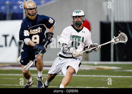 Mar. 06, 2010 - Baltimore, Maryland, U.S - 06 March 2010: Notre Dame Defense Mike Creighton #9 and Loyola Attack - Stock Photo