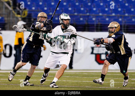 Mar. 06, 2010 - Baltimore, Maryland, U.S - 06 March 2010: Loyola Attack D.J. Comer #23 and Notre Dame LSM Andrew - Stock Photo