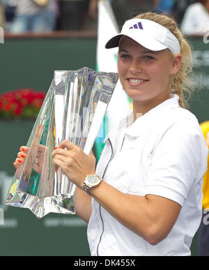 Mar. 20, 2011 - Indian Wells, California, U.S - No. 1 seed Caroline Wozniacki (DEN) poses with their trophy after - Stock Photo