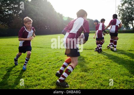 Teenage schoolboy rugby team in practice - Stock Photo