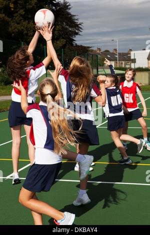 Teenage schoolgirl netball team in practice - Stock Photo
