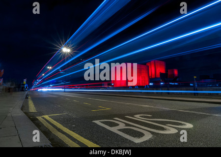 Waterloo Bridge, London, UK - light trails from passing traffic on Waterloo Bridge at night - Stock Photo