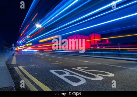 Waterloo Bridge, London, UK - light trails from passing traffic on Waterloo Bridge at night - Stock Photo