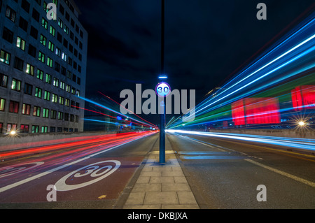 Waterloo Bridge, London, UK - traffic passes a 30 miles per hour sign on Waterloo Bridge - Stock Photo