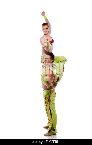 Smiling young artists posing in colorful costumes - Stockfoto