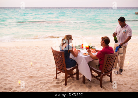 Private dining on the beach at Kuramathi Island Resort, Maldives. - Stock Photo